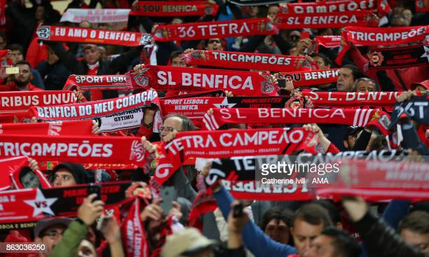 Fans of Benfica hold up scarves during the UEFA Champions League group A match between SL Benfica and Manchester United at Estadio da Luz on October...