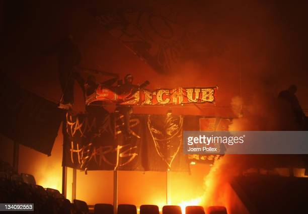 Fans of Berlin light flares during the Second Bundesliga match between FC Hansa Rostock and Union Berlin at DKB Arena on November 25 2011 in Rostock...