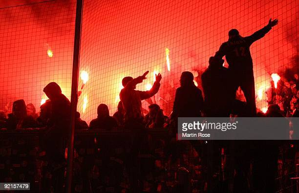 Fans of besiktas light fireworks during the UEFA Champions League Group B match between VfL Wolfsburg and Besiktas Istanbul at Volkswagen Arena on...