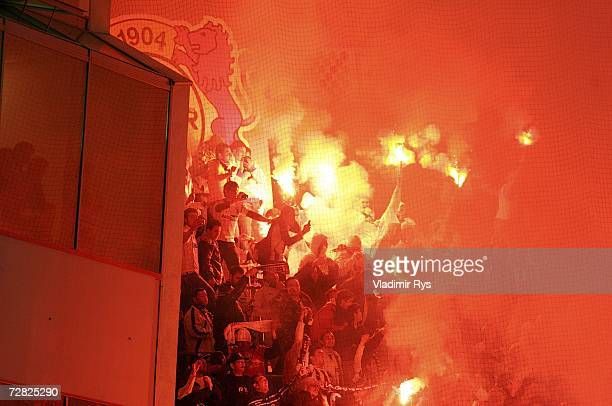 Fans of Besiktas light up flares during the UEFA Cup Group B match between Bayer Leverkusen and Besiktas Istanbul at the BayArena on December 14 2006...