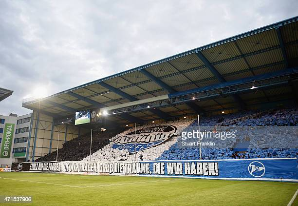 Fans of Bielefeld perform a fan choreography prior to the DFB Cup Semi Final match between Arminia Bielefeld and VfL Wolfsburg at Schueco Arena on...