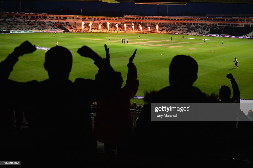 Fans of Birmingham Bears celebrate their team taking a wicket during the NatWest T20 Quarter Final match between Birmingham Bears and Essex Eagles at...