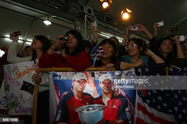 Fans of Bob Bryan and Mike Bryan of the United States cheer as brother Bryan perform after their round robin match against Jeff Coetzee of South...