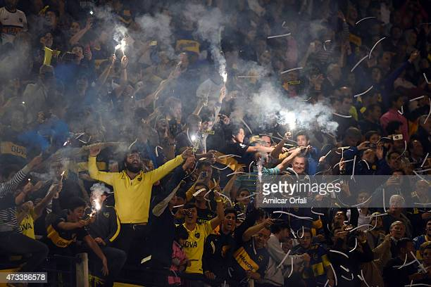 Fans of Boca Juniors cheer for their team as they light flares during a second leg match between Boca Juniors and River Plate as part of round of...