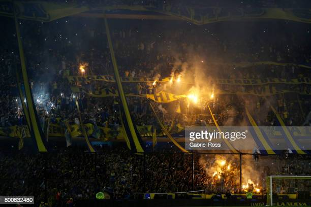 Fans of Boca Juniors cheer for their team during a match between Boca Juniors and Union as part of Torneo Primera Division 2016/17 at Alberto J...
