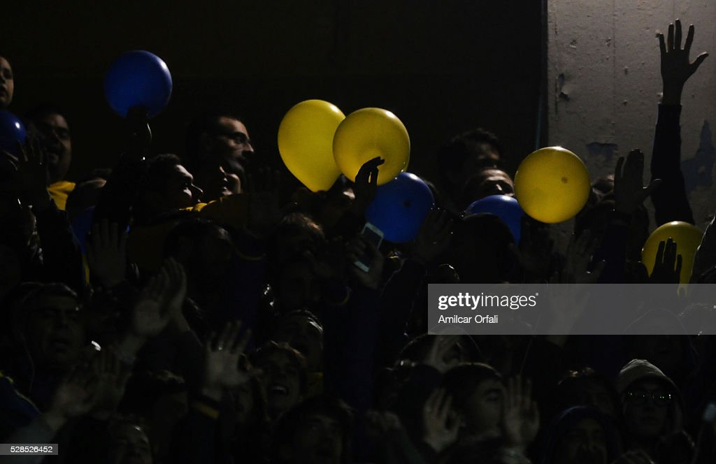 Fans of Boca Juniors cheer for their team during a second leg match between Boca Juniors and Cerro Porteno as part of round of sixteen of Copa Bridgestone Libertadores 2016 at Alberto J Armando Stadium on May 05, 2016 in Buenos Aires, Argentina.