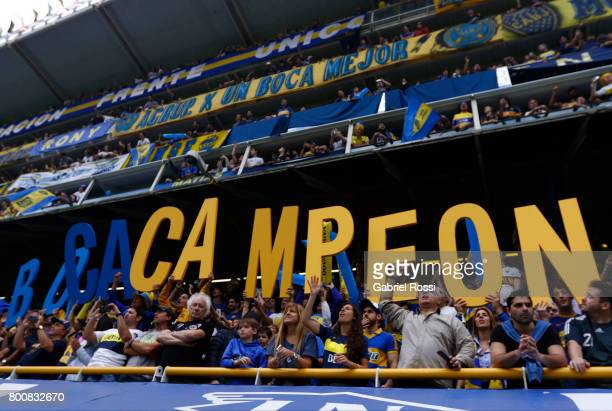 Fans of Boca Juniors cheer for their team prior a match between Boca Juniors and Union as part of Torneo Primera Division 2016/17 at Alberto J...