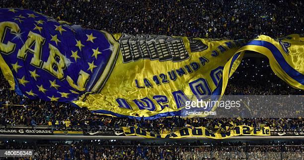Fans of Boca Juniors display a huge flag during Carlos Tevez presentation as new player of Boca Juniors at Alberto J Armando Stadium on July 13 2015...