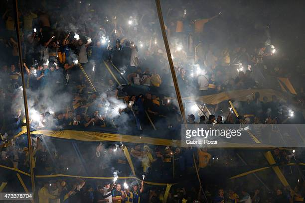 Fans of Boca Juniors light flares to cheer their team prior a second leg match between Boca Juniors and River Plate as part of round of sixteen of...