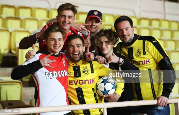 Fans of Borussia Dortmund and fans of Monaco pose for a photo after the UEFA Champions League Quarter Final second leg match between AS Monaco and...