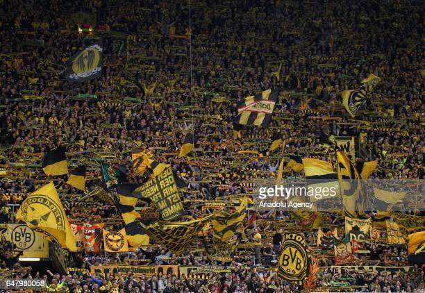 Fans of Borussia Dortmund are seen during the Bundesliga soccer match between Borussia Dortmund and Bayer 04 Leverkusen at the Signal Iduna Park in...
