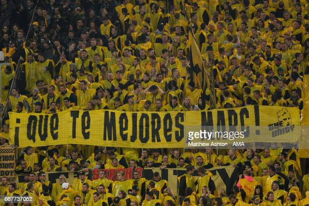 Fans of Borussia Dortmund show support for Marc Bartra during the UEFA Champions League Quarter Final first leg match between Borussia Dortmund and...
