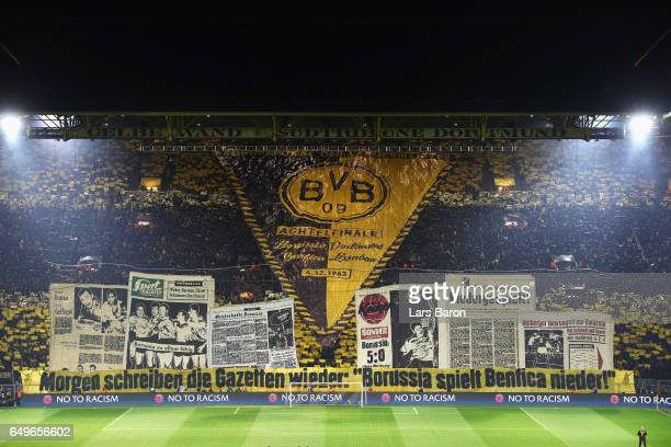 Fans of Borussia Dortmund show their support with flags banners and signs prior to the UEFA Europa League Round of 16 first leg match between...