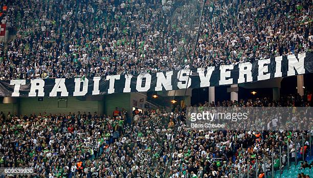Fans of Borussia Moenchengladbach show banners during the Bundesliga match between RB Leipzig and Borussia Moenchengladbach at Red Bull Arena on...