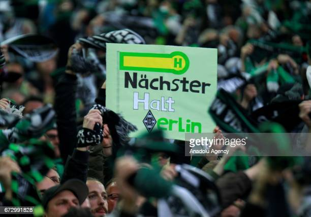 Fans of Borussia Monchengladbach hold a banner reading 'next stop Berlin' during the DFB Cup semifinal soccer match between Borussia Monchengladbach...