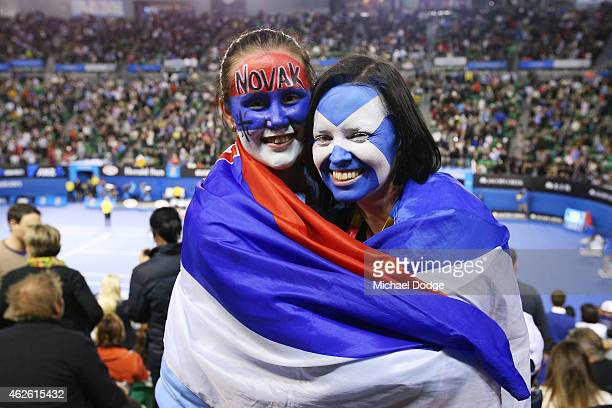 Fans of both Novak Djokovic of Serbia and Andy Murray of Great Britain watch the action in their men's final match during day 14 of the 2015...