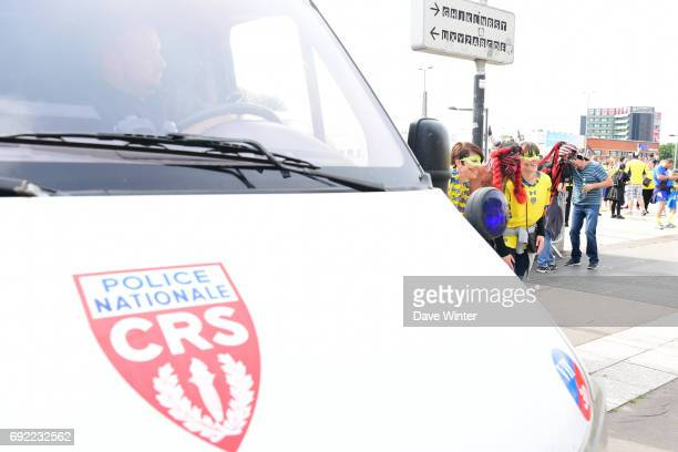 Fans of both sides mingle outside the stadium under the watchful eyes of a reinforced security the the Top 14 Final between RC Toulon and Clermont...