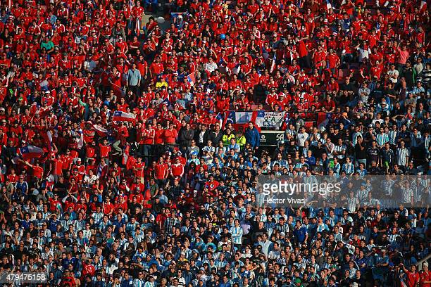 Fans of both teams are seen in the tribune during the 2015 Copa America Chile Final match between Chile and Argentina at Nacional Stadium on July 04...