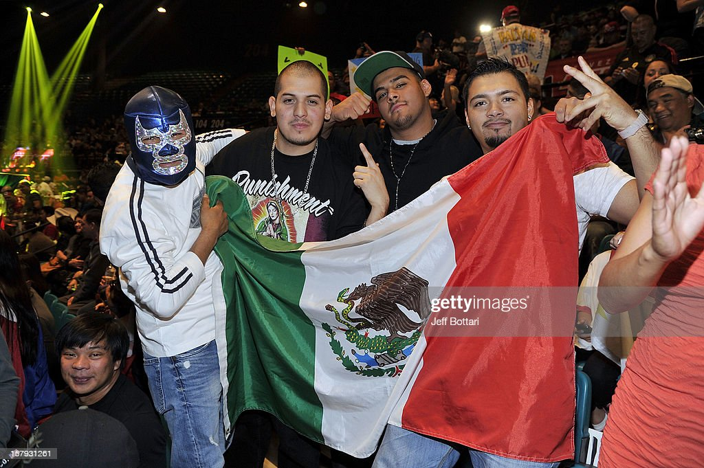Fans of boxer Juan Manuel Marquez pose during the official weigh-in for his welterweight bout against Manny Pacquiao at the MGM Grand Garden Arena on December 7, 2012 in Las Vegas, Nevada. Pacquiao and Marquez will fight each other for the fourth time on Dec. 8 in Las Vegas.