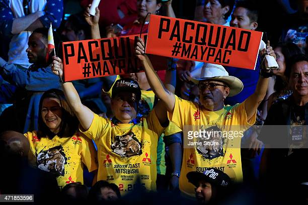 Fans of boxer Manny Pacquiao cheer before the official weighin for Floyd Mayweather Jr and Pacquiao on May 1 2015 at MGM Grand Garden Arena in Las...