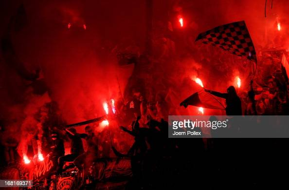 Fans of Braunschweig celebrate after the 2 Bundesliga match between Eintracht Braunschweig and Energie Cottbus at Eintracht Stadion on May 6 2013 in...