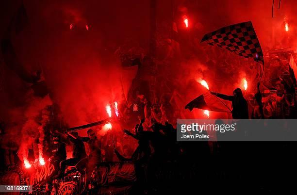 Fans of Braunschweig celebrate after the 2 Bundesliga match between Eintracht Braunschweig and Energie Cottbus at Eintracht Stadion on May 6 2013 in...