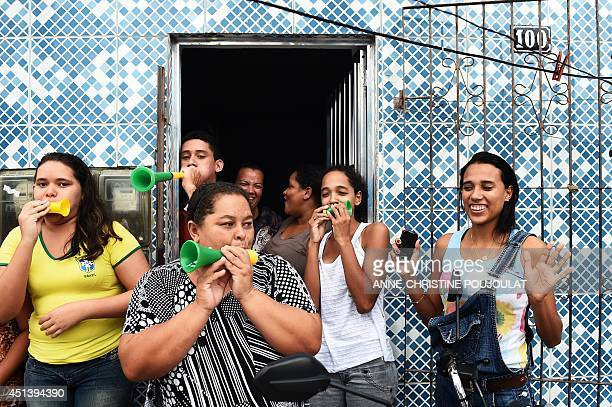 Fans of Brazil celebrate at the end of the match on June 28 in Porto Seguro as they watch the Round of 16 football match between Brazil and Chile...