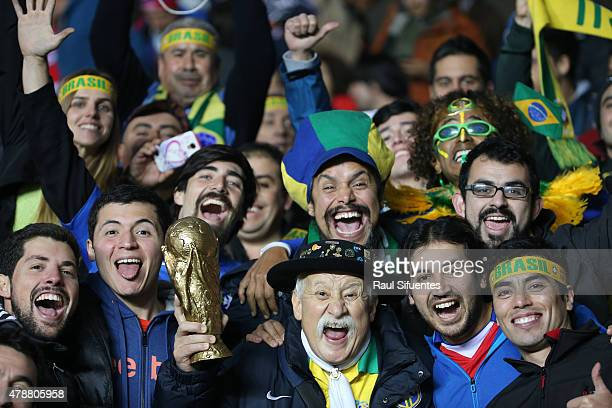 Fans of Brazil cheer for their team during the 2015 Copa America Chile quarter final match between Brazil and Paraguay at Ester Roa Rebolledo Stadium...