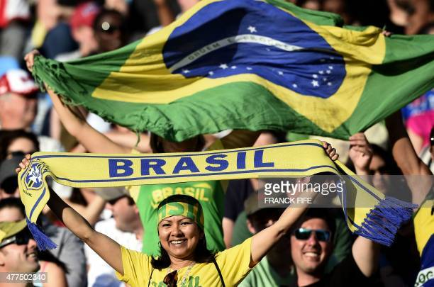 Fans of Brazil cheer prior to the Group E match at the 2015 FIFA Women's World Cup between Costa Rica and Brazil at Moncton Stadium New Brunswick on...
