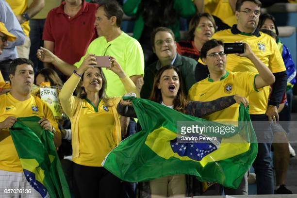 Fans of Brazil cheer their team prior to a match between Uruguay and Brazil as part of FIFA 2018 World Cup Qualifiers at Centenario Stadium on March...