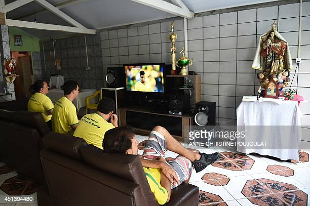 Fans of Brazil watch the match on June 28 in Porto Seguro during the Round of 16 football match between Brazil and Chile being held at the Mineirao...