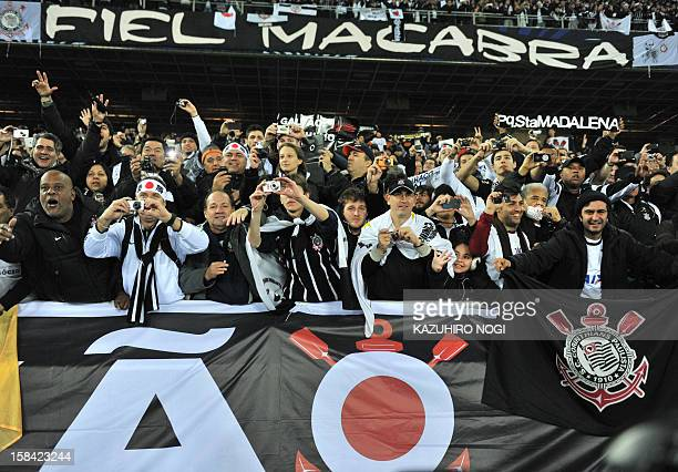 Fans of Brazilian giants Corinthians celebrate their team's victory after the 2012 Club World Cup football final match at Yokohama on December 16...