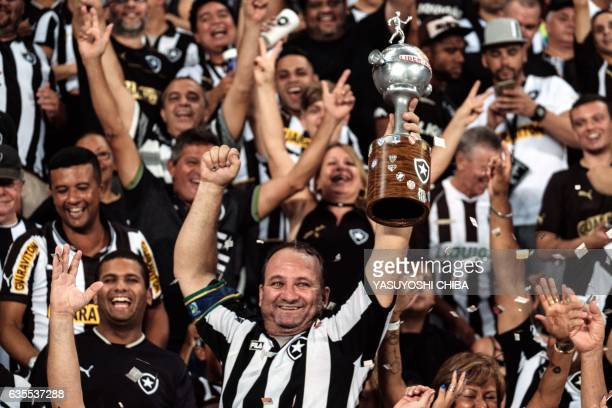 Fans of Brazil's Botafogo cheer before their Copa Libertadores 2017 football match aganst Paraguay's Olimpia for the Copa Libertadores 2017 at the...