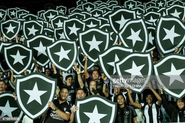 Fans of Brazil's Botafogo react before their Copa Libertadores 2017 football match against Ecuador's Barcelona at the Nilton Santos Olympic...