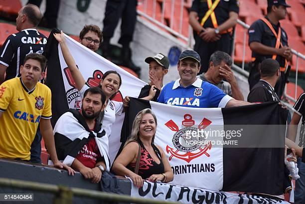 Fans of Brazil's Corinthians cheer during their Copa Libertadores 2016 football match against Paraguay's Cerro Porteno at Defensores del Chaco...