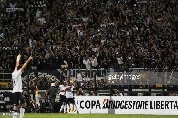 Fans of Brazil's Corinthians reacts after Paulinho's score against Mexico's Tijuana during their Copa Libertadores match at Pacaembu stadium in Sao...