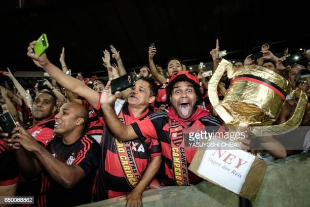 Fans of Brazil's Flamengo celebrate after winning against Fluminense the Copa Carioca football match at Maracana stadium in Rio de Janeiro Brazil on...