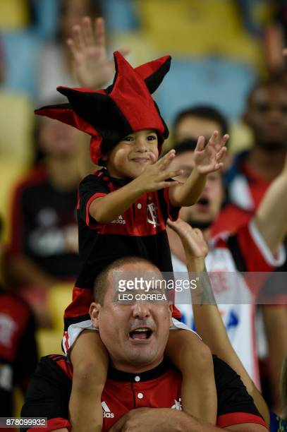 Fans of Brazil's Flamengo cheer before the Copa Sudamericana first leg semifinal football match against Colombia's Junior de Barranquilla at Maracana...