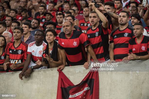 Fans of Brazil's Flamengo cheer during their Libertadores Cup football match against Argentina's San Lorenzo at Maracana stadium in Rio de Janeiro...