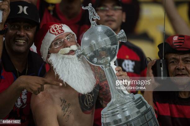 Fans of Brazil's Flamengo pose for photographers before their Libertadores Cup football match against Argentina's San Lorenzo at Maracana stadium in...