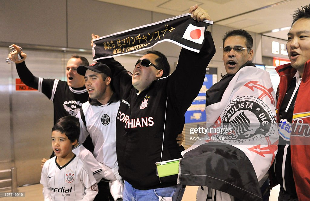 Fans of Brazil's football club team Corinthians cheer as players arrive for the Club World Cup at Narita airport on December 6, 2012.