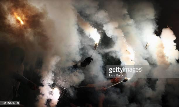 Fans of Bremen burn flares during the Bundesliga match between Bayer 04 Leverkusen and Werder Bremen at BayArena on March 10 2017 in Leverkusen...