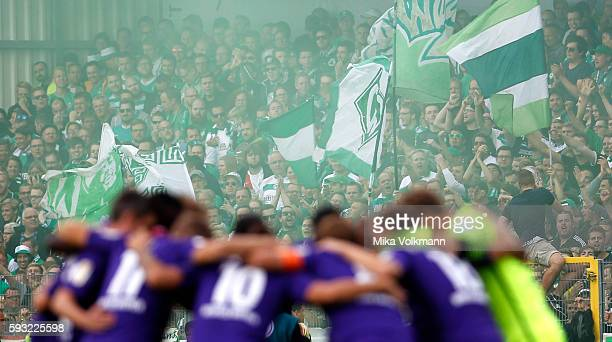 Fans of Bremen celebrates theiur team prior the DFB Cup match between Sportfreunde Lotte and SV Werder Bremen at the Frimo Stadion on August 21 2016...