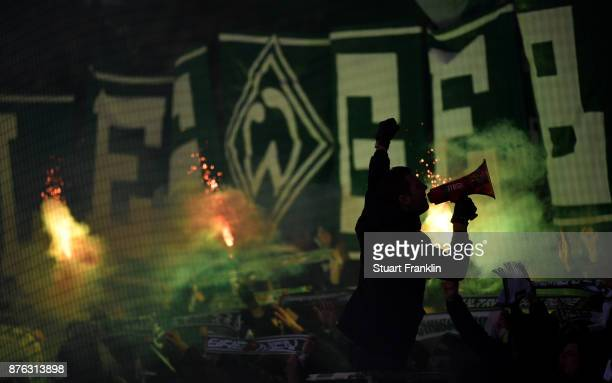 Fans of Bremen let flairs during the Bundesliga match between SV Werder Bremen and Hannover 96 at Weserstadion on November 19 2017 in Bremen Germany