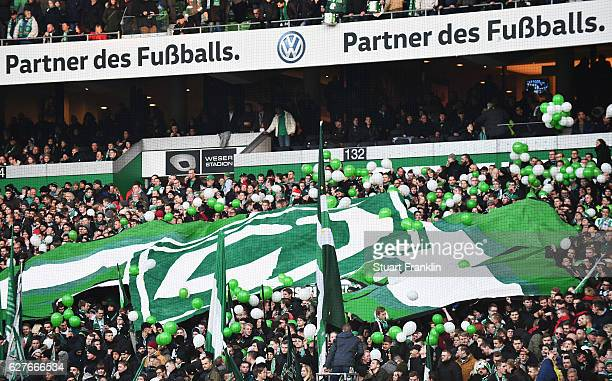 Fans of Bremen support their team during the Bundesliga match between Werder Bremen and FC Ingolstadt 04 at Weserstadion on December 3 2016 in Bremen...