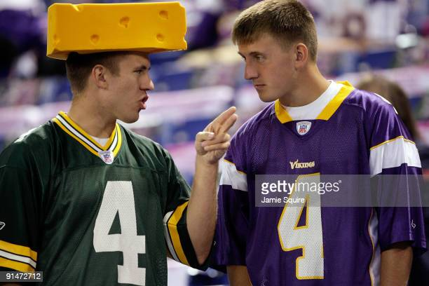 Fans of Brett Favre of the Minnesota Vikings talk prior to the start of the game against of the Green Bay Packers on October 5 2009 at Hubert H...