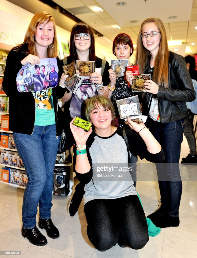Fans of Bring Me The Horizon meet the band signing copies of a new HMV Exclusive T-Shirt at HMV Birmingham Bullring on November 2, 2013 in Birmingham, England.