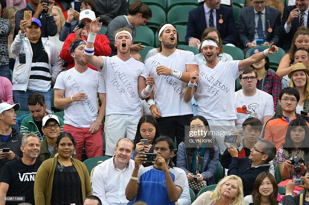 Fans of Britain's Marcus Willis sing in the crowd before the start of the men's singles second round match between Switzerland's Roger Federer and Britain's Marcus Willis on the third day of the 2016 Wimbledon Championships at The All England Lawn Tennis Club in Wimbledon, southwest London, on June 29, 2016. / AFP / GLYN