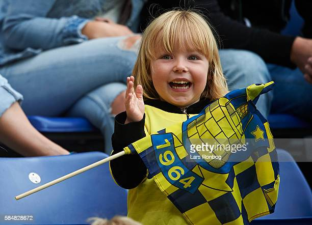 Fans of Brondby IF cheer during the Danish Alka Superliga match between Brondby IF and AC Horsens at Brondby Stadion on July 31 2016 in Brondby...