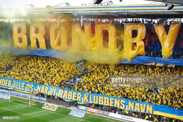 Fans of Brondby IF cheer with a tifo prior to the Danish Alka Superliga match between Brondby IF and FC Copenhagen at Brondby Stadion on April 17...